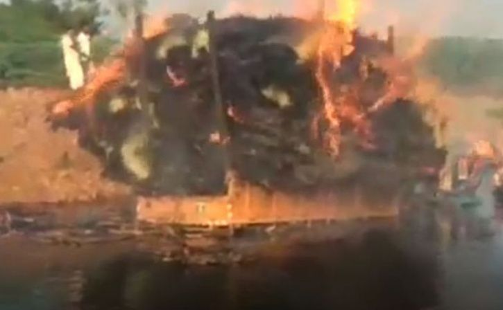 man drives burning tractor into lake to save more than 100 homes