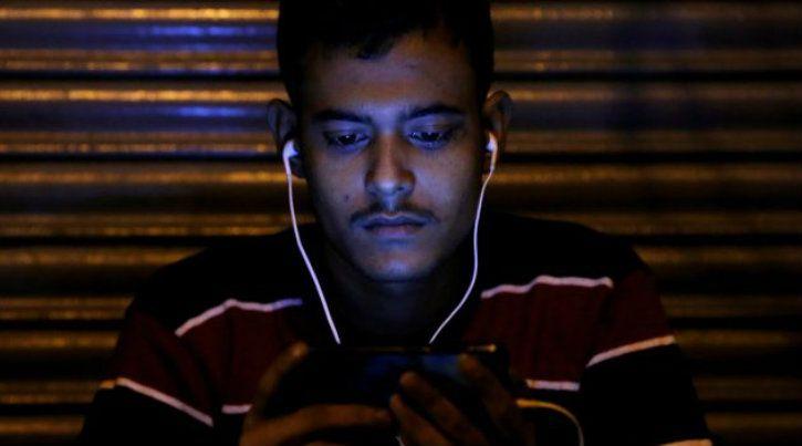 man using phone internet in india