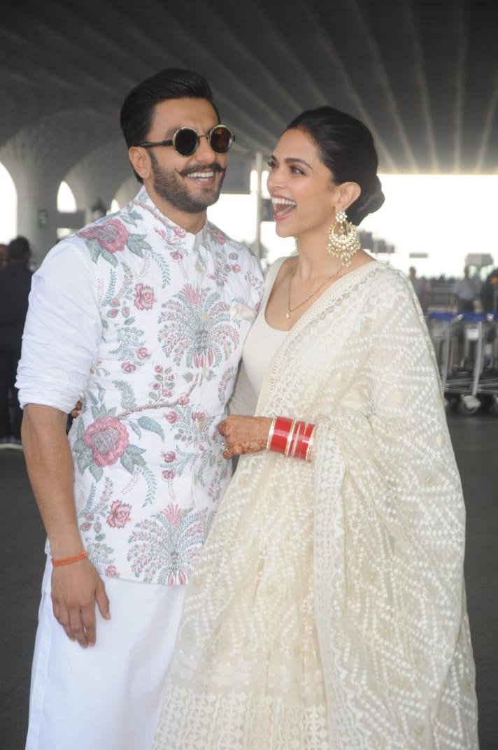 Ranveer Singh and Deepika Padukone pose at Mumbai airport heading to Bengaluru for wedding reception
