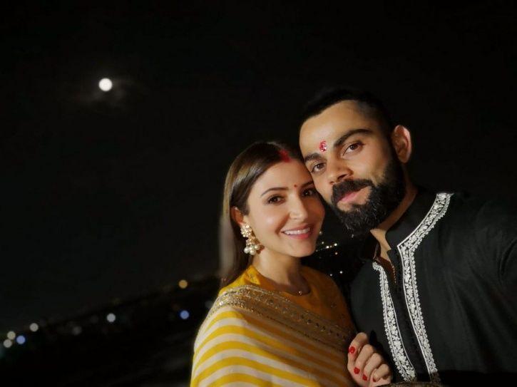 A picture of Virat Kohli and Anushka Sharma celebrating their first KarvaChauth.