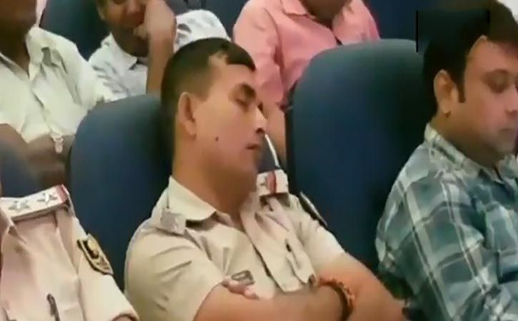 cops caught sleeping during a briefing on law and order