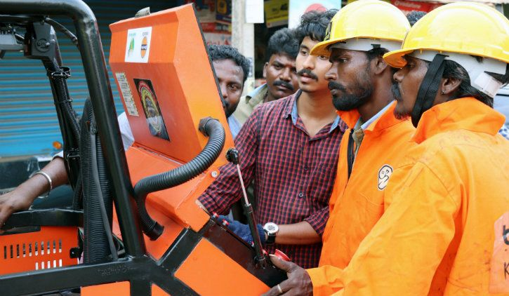 Team GenRobotics training sanitation workers in Kerala