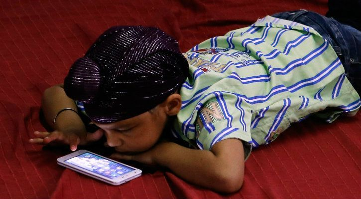 smartphone kid using an android phone addiction blue whale challenge