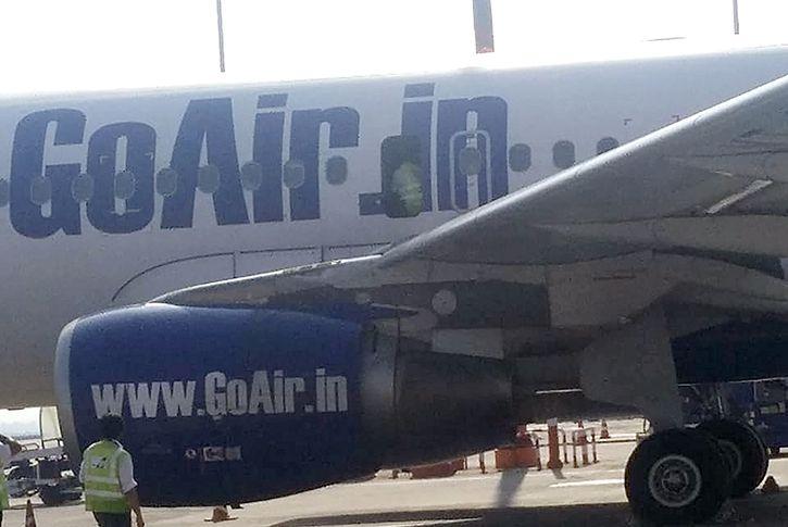 man open emergency exit in plane