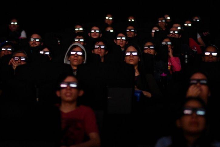 People watching Avengers Endgame in cinema halls.