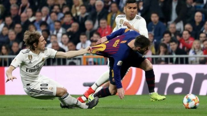 Luka Modric pulled down Lionel Messi