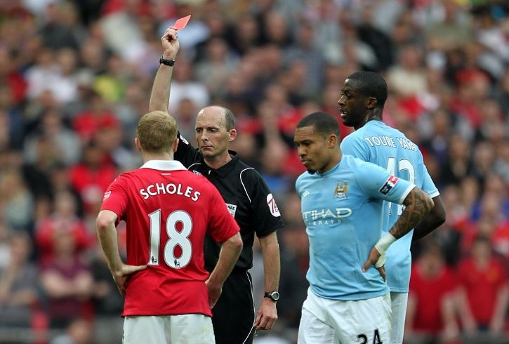 Mike Dean is on 99 red cards