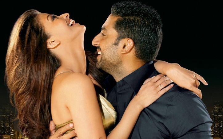 Aishwarya Rai Bachchan and Abhishek Bachchan laughing together.
