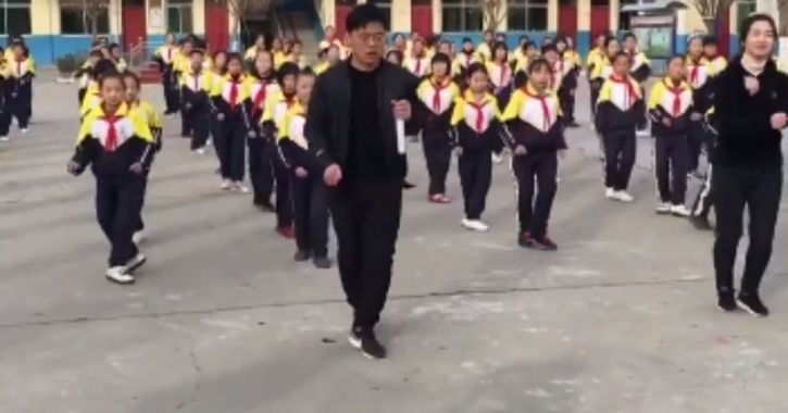 Chinese School Principal Dances With Students