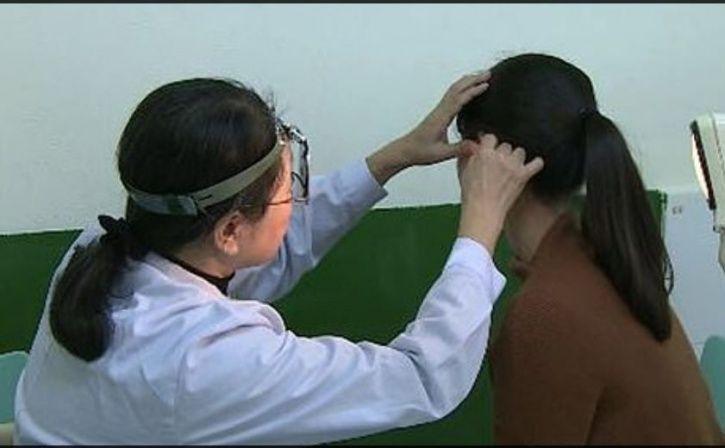 hearing aid, China, Dr Lin Xiaoqing, reverse-slope, diagnosis, symptoms, nausea