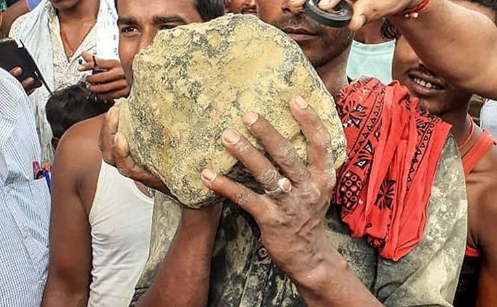 India Farmers Shocked As Suspected Meteorite Crashes Into Rice Field