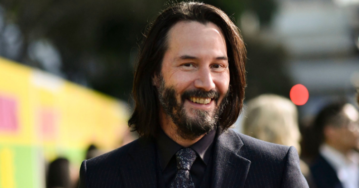 A picture of Keanu Reeves smiling.