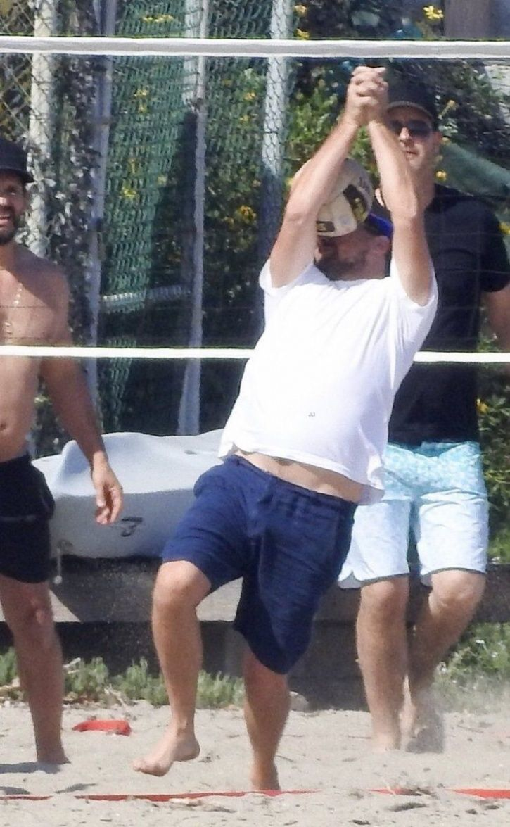 Leonardo DiCaprio gets hit by a volleyball with Robin Thicke and his fiancée Camila Morrone.