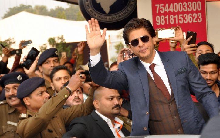 Shah Rukh Khan waving hands.