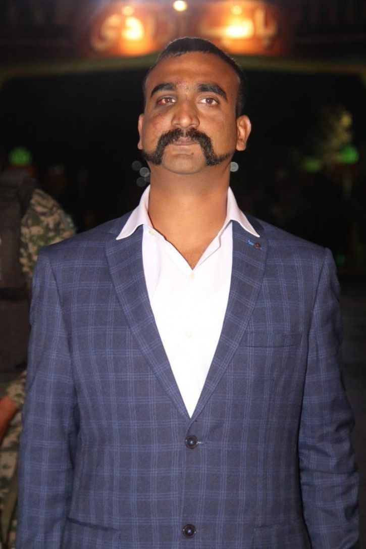 A man watches a statement of Indian Air Force pilot Abhinandan Varthaman on his mobile phone, releas
