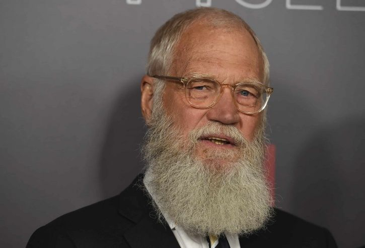 A picture of David Letterman who is likely to host Shah Rukh Khan.