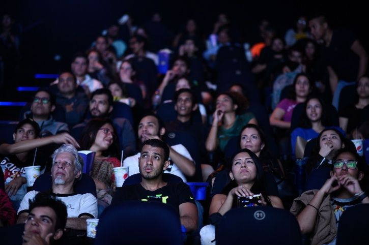People watching Avengers: Endgame in theatres.