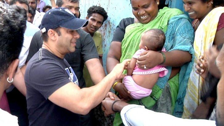 Salman Khan playing with a kid.