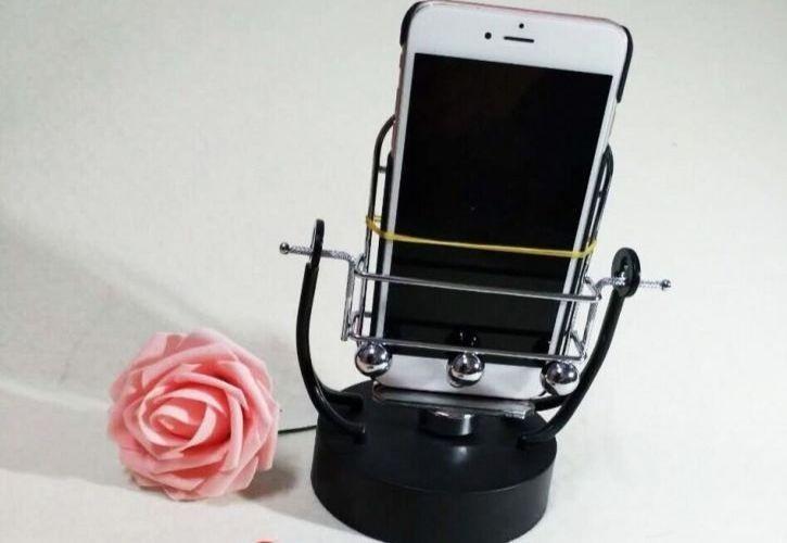 swinging phone cradle