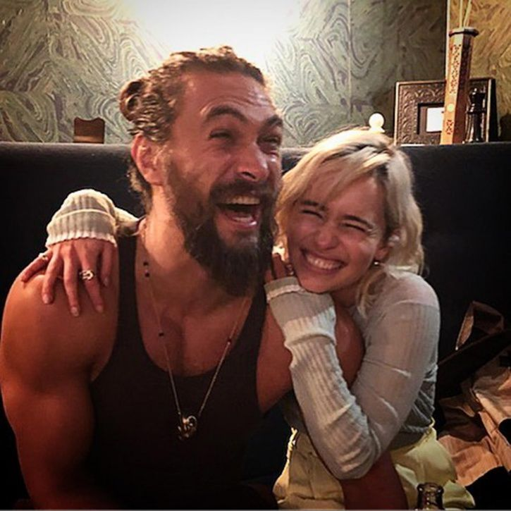 Emilia Clarke says Jason Momoa helped her during nude scenes on Game of Thrones.
