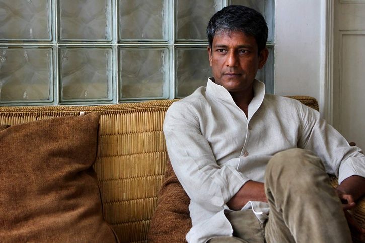 A picture of Adil Hussain.