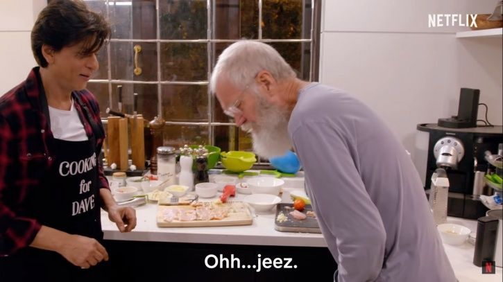 David Letterman is helping him by chopping veggies, he pretends to have cut his finger.