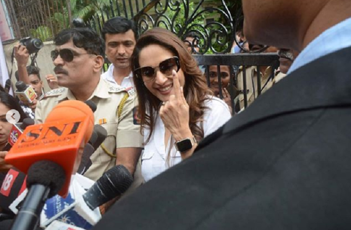 Madhuri Dixit also posed for the paps after she casted her vote in Bandra.