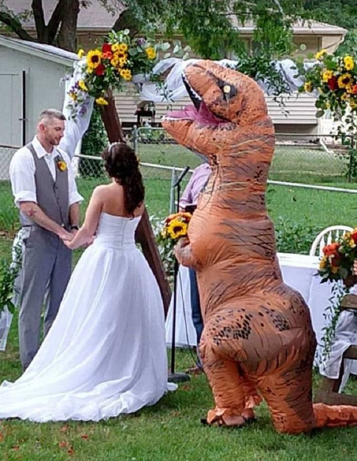 Christina, bridesmaid and maid of honor, decides to wear a dinosaur costume to her sister