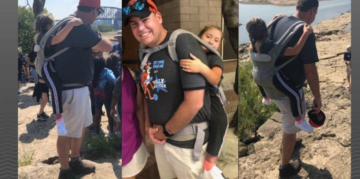 elementary teacher carries 10 year old child