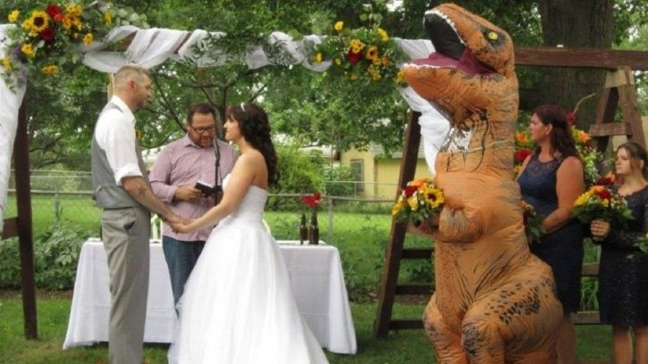 Maid of Honour arrived in T-rex costume.