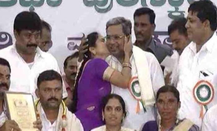 Peck On Cheek Leaves Karnataka CM Embarrassed