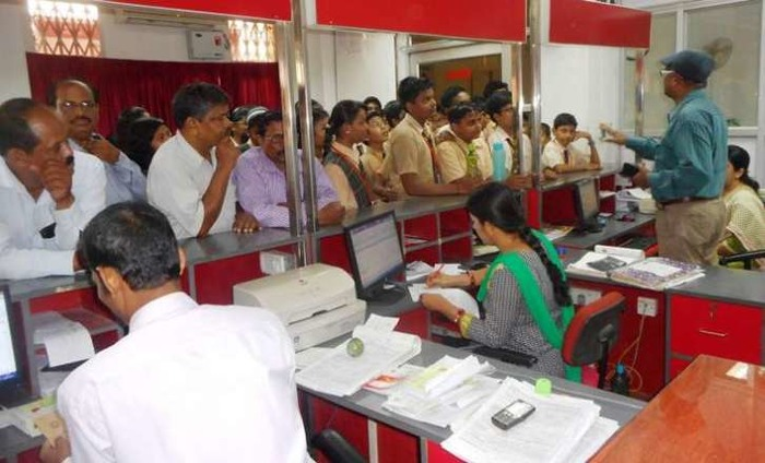 Unsung Heroes: Bank Staff Work Overtime To Manage Cash Flow