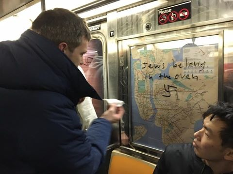 New York Commuters Wiping Off Nazi Graffiti On Subway Will Restore Faith In Humanity