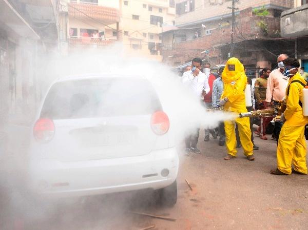 workers spray disinfectant