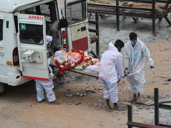 Bodies of people who died of COVID-19 are cremated at an open crematorium of Bengaluru.